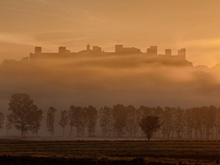 Alba sul castello di Monteriggioni